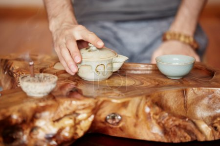 Chinese tea ceremony is performed by tea master at home