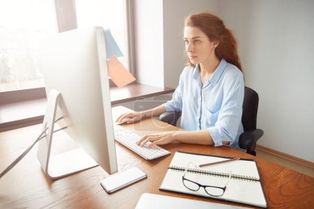 female office worker keyboarding on the computer