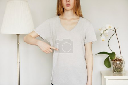 girl pointing at blank T-shirt