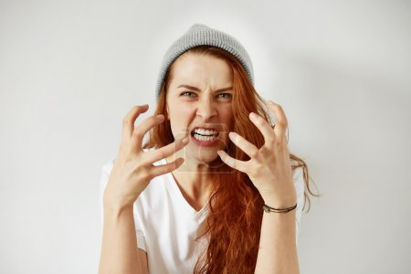 Photo for Close up portrait of young annoyed angry woman holding hands in furious gesture - Royalty Free Image