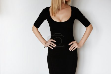 attractive woman in black low dress