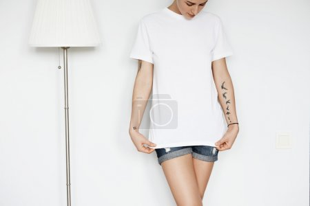 Woman with tattooed arms