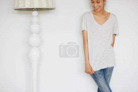 brunette female in loose gray T-shirt