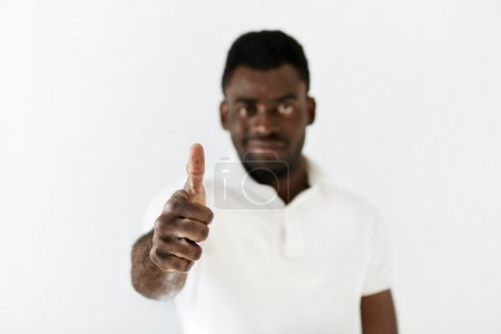 African male gesturing thumbs up