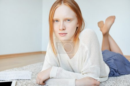woman with red hair relaxing on floor