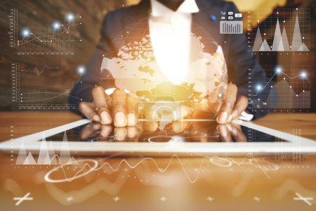 man's hands holding digital tablet