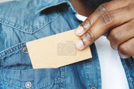 black male holding blank card