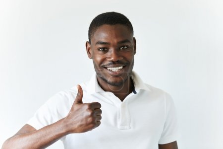 successful African freelancer gesturing thumbs-up