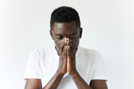 African man wearing white T-shirt