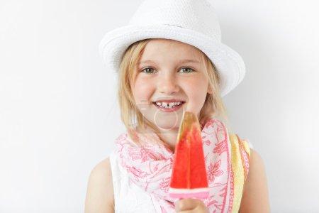 Blond child with yummy lollipop