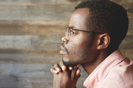 Young black man in glasses