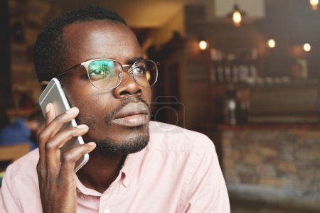 African corporate worker on phone