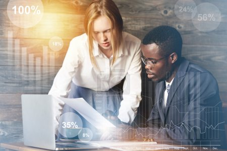 Worldwide connection. African entrepreneur in glasses and formal wear holding papers, pointing with a pen, asking his redhead Caucasian assistant to redo a report as soon as possible. Visual effects