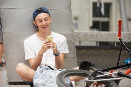 Schoolboy using mobile phone