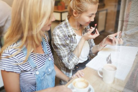 girls doing make-up and drink coffee