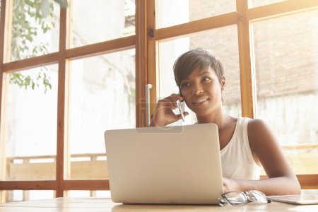 female boss talking on phone with partners