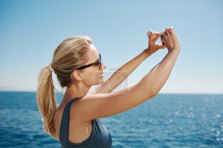 Happy fitness selfie woman smiling taking self portrait photogra