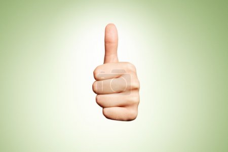 Woman hand with thumb up isolated on green background. Good sign