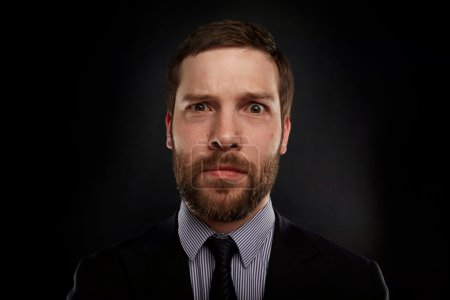 Closeup portrait of handsome businessman looking shocked, surprised in disbelief, with hands on face looking at you camera, isolated on background. Positive human emotions, facial expressions.