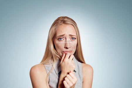 Closeup portrait stressed frustrated woman crying or weep having temper tantrum isolated on wall background. Negative human emotion facial expression reaction attitude