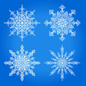set of 4 radial patterns snowflake star on a blue background