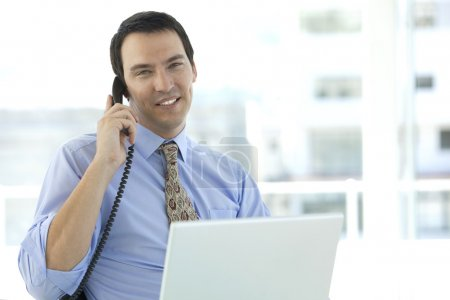 Middle-aged businessman on the phone