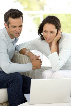 Photo for Mature couple using laptop at home - Royalty Free Image