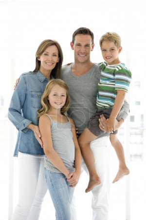 Photo for Portrait of a standing happy family. Studio shot with white background. Dad holding boy in arm. - Royalty Free Image