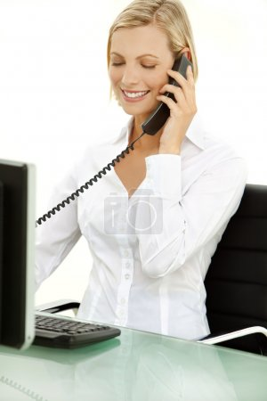 Young blond hair businesswoman on the phone