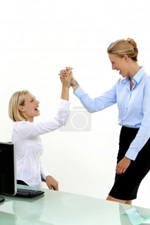 Employees High five at workplace