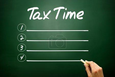 Hand drawn TAX TIME blank list, business concept on blackboar