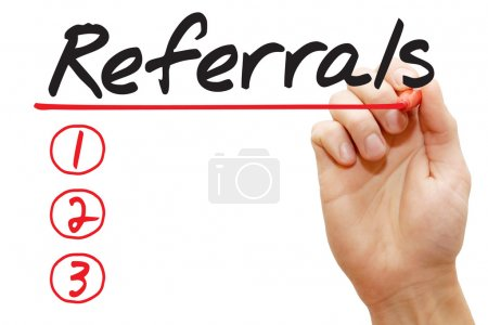 Hand writing Referrals List, business concep