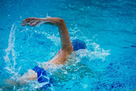 young male athlete swimmer crawl