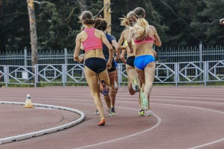 Photo for Group of women athletes running in stadium during athletics competitions - Royalty Free Image