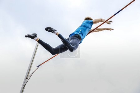 male athlete high jump pole