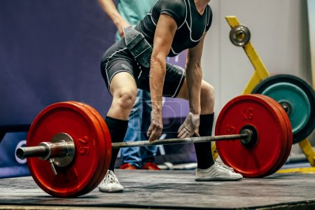 female powerlifter preparing for deadlift