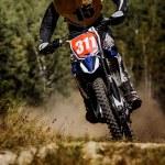 Постер, плакат: Male racer on racing motorcycle