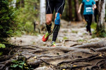 running marathon runner in forest.