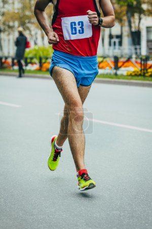 Male athlete running on the road