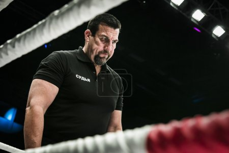 referee John McCarthy in ring closeup