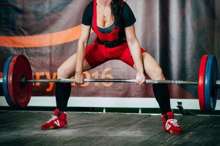girl athlete exercise deadlift