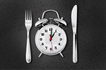 Photo for Alarm clock with knife and fork  for mealtime or diet concept - Royalty Free Image