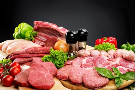 Photo for Fresh Raw Meat Background with vegetables - Royalty Free Image