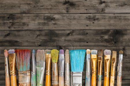 Photo for Row of artist paint brushes  on background - Royalty Free Image