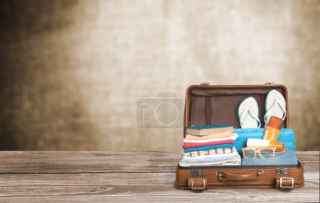 retro suitcase with travel objects