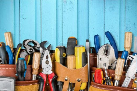 Photo for Tool belt with tools on wooden background - Royalty Free Image