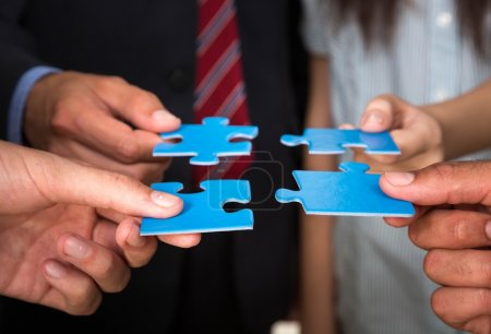 Photo for Business people holding puzzle pieces. problem solution concept - Royalty Free Image