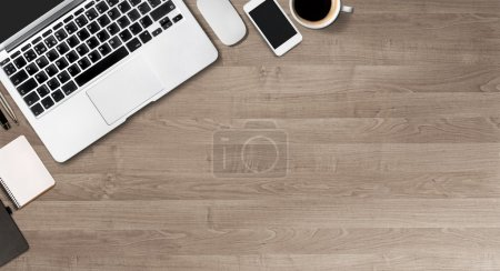 Photo for Office stuff with smart phone, laptop  and coffee cup - Royalty Free Image