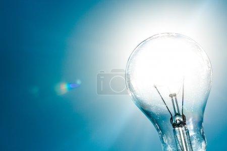 Shining light bulb. solar energy concept...