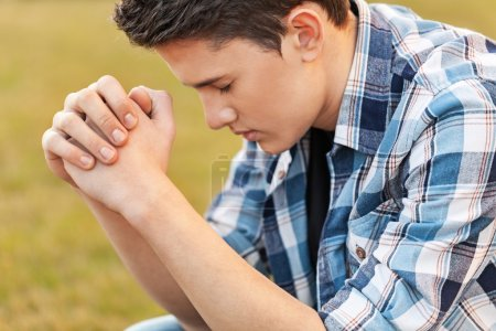 Handsome Young man  praying